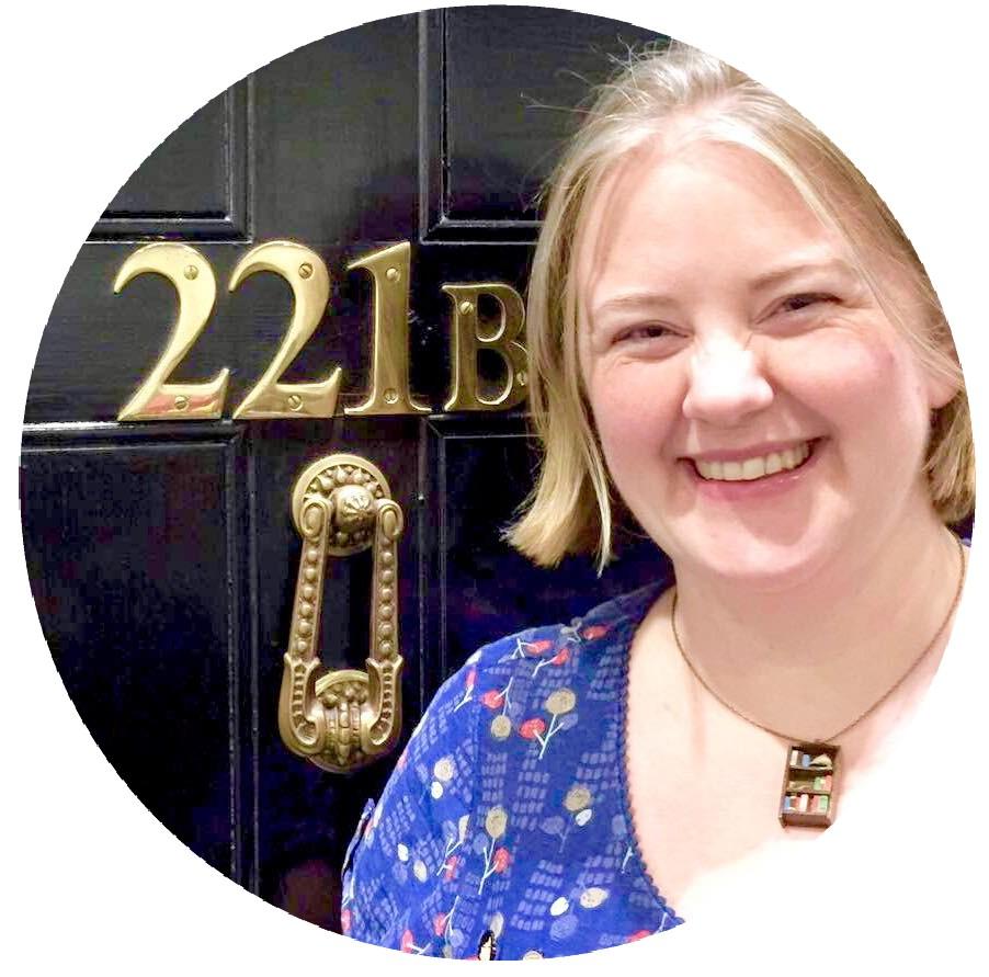 Photo of Sarah standing in front of the door to 221B Baker Street